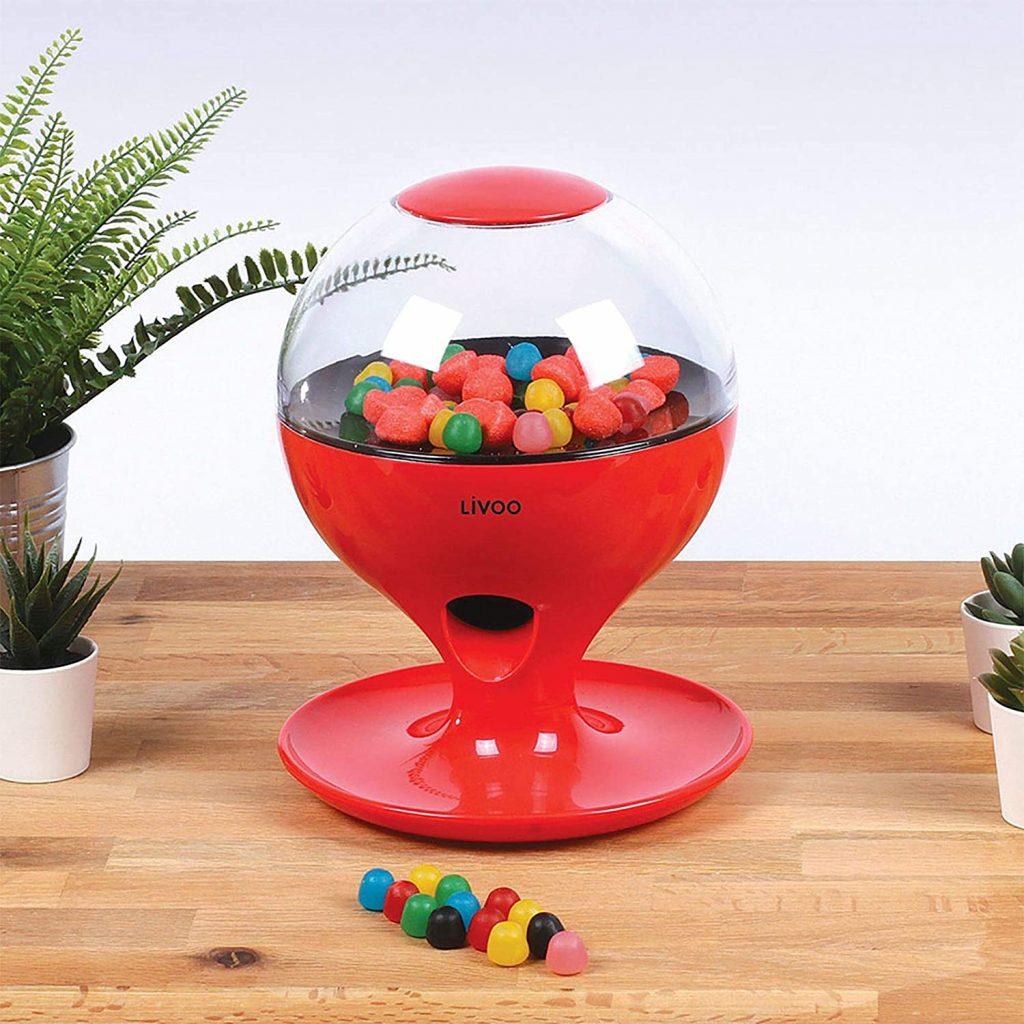 Distributeur de bonbons et de chewing-gums avec capteur de mouvement